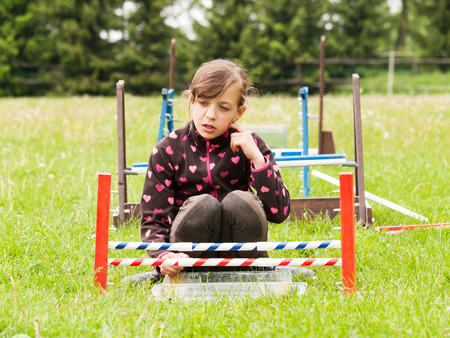 Girl behind fence for rabbit jumping photo