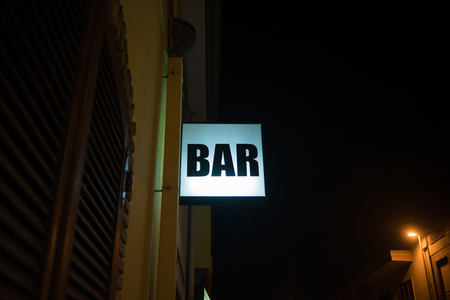 Bar Neon sign illuminated at night Stock Photo