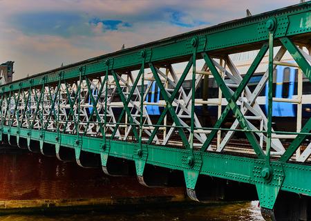 metal bridge over river thames Stock Photo