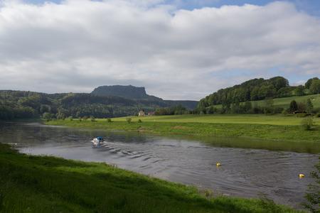 Rapeseed field in Saxon Switzerland with Lilienstein rock formation