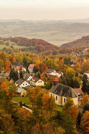 Church under Tisa rocks or Tisa walls in western Bohemian Switzerland, part of the Elbe Sandstone Rocks, Czech Republic 版權商用圖片