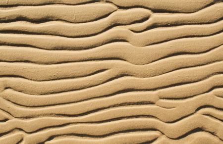 lopsided: Wavy patterns on coastal sand Stock Photo