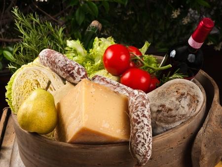 cheese,salami,tomatoes and vine