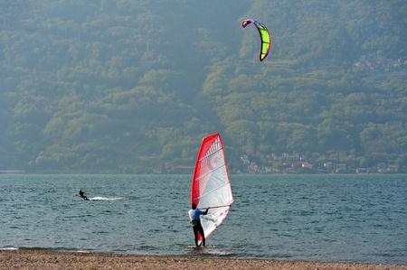 windsurfers: two windsurfers on the lake Stock Photo