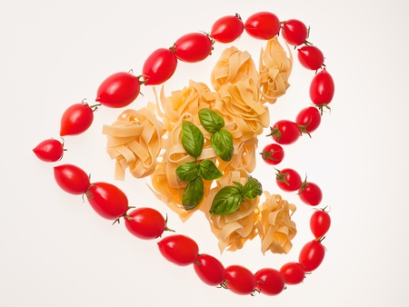Tomatoes heart with pasta photo