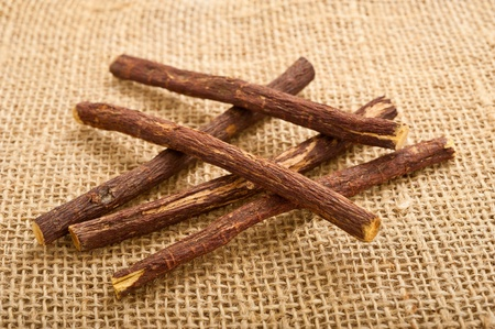 Licorice roots on the jute Stock Photo - 9855655