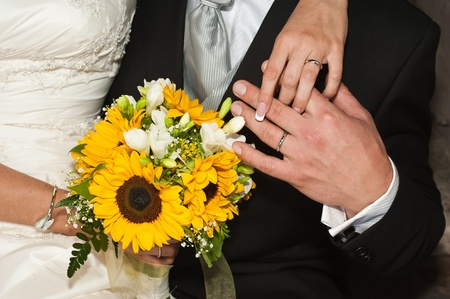 Hands married with rings and bouquets Stock Photo - 9970362