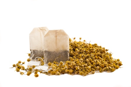 sachets: Sachets and chamomile flowers on white