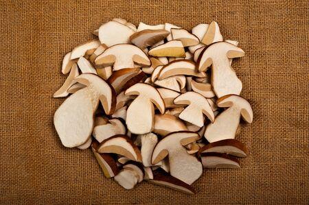 uncultivated: Sliced mushrooms on jute background