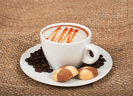 Cappuccino, biscuits  and coffee beans photo