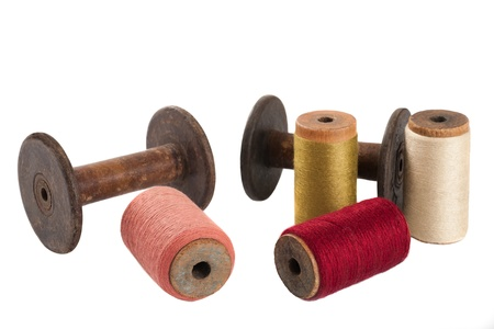 old spools: Colored threads wound on bobbins