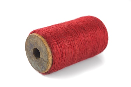 old spools: Red yarn wound on bobbin
