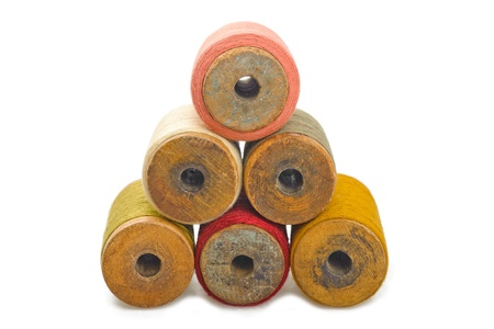 old spools: Colored spools of cotton thread
