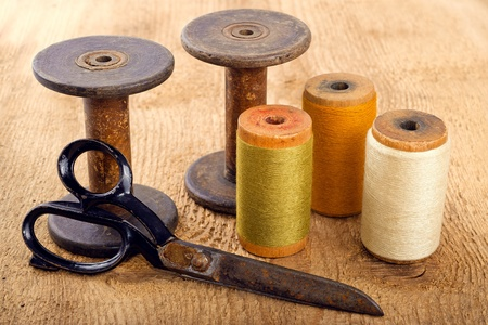 old spools: Scissors and spools  on wooden background Stock Photo