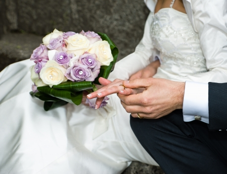 Married couple with rings and bouquet photo
