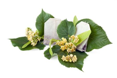 sachets: Linden leaf and flowers isolated on white with teabags