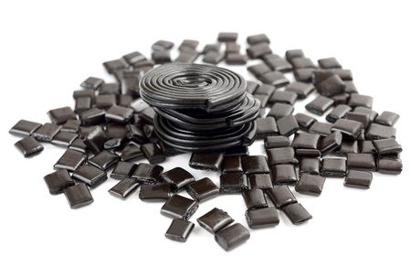 licorice candy and licorice   wheels isolated on white photo