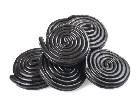 licorice wheels isolated on white Stock Photo