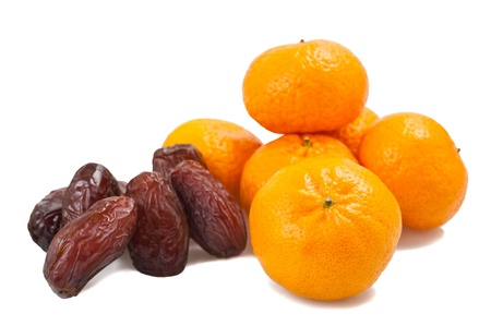 vitamines: Mandarins with dates isolated on white Stock Photo