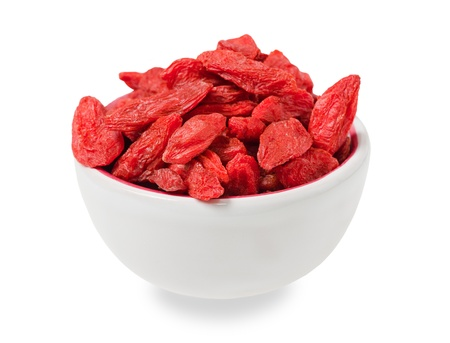 herbology:  bowl of goji isolated on white