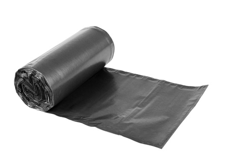 closeup on bags: Rolls  of disposable trash bags isolated over white background