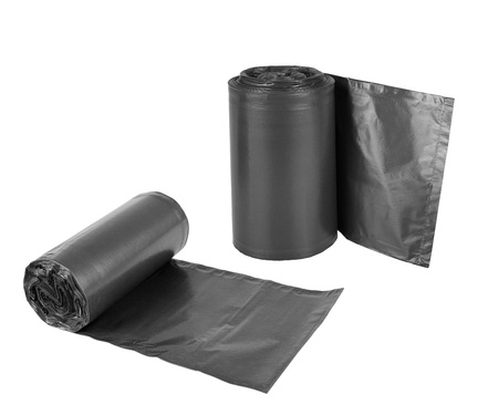 neatness: Rolls  of disposable trash bags isolated over white background