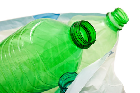 plastic bottles in the trash on white background photo