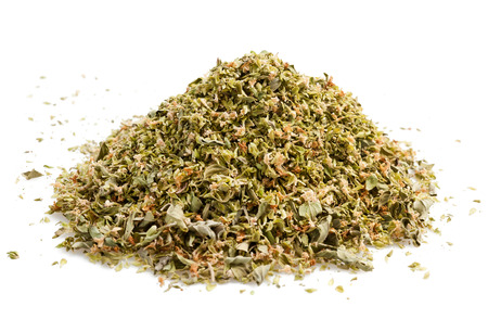 dried herbs: oregano pile isolated on a white background