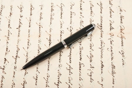 pen with vintage hand written letter photo