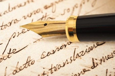 Fountain pen on an antique handwritten letter Stok Fotoğraf