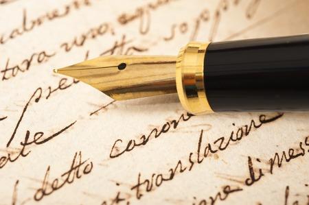 calligraphy pen: Fountain pen on an antique handwritten letter Stock Photo