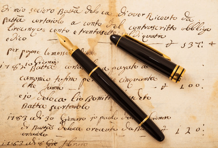 fountain pen writing: Fountain pen with cap on an antique  letter Stock Photo
