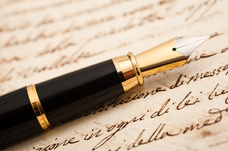 fountain pen writing: Fountain pen on an antique handwritten letter Stock Photo