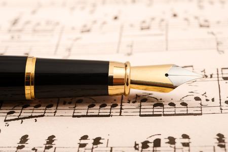fountain pen writing: Old sheet music with fountain pen Stock Photo