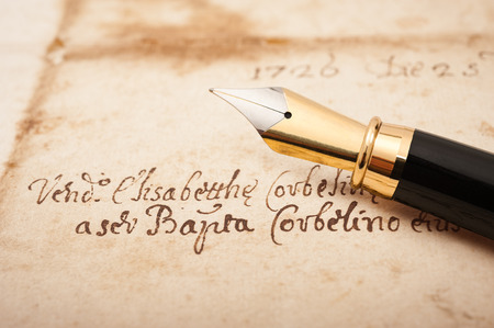 fountain pen writing: Fountain pen on an antique  letter