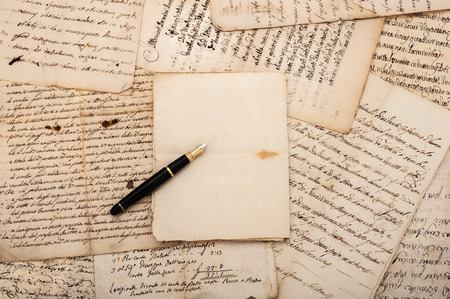 note book: Fountain pen on  antique  letters and empty sheet Stock Photo