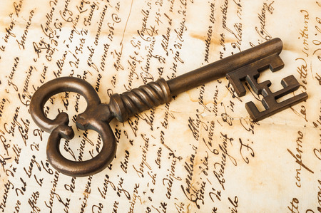 passkey: Old key on letter background Stock Photo