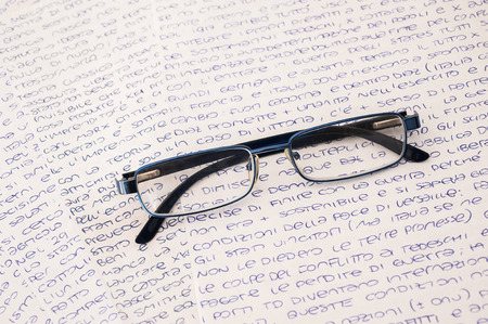 glasses on a background of letters photo