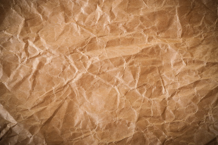 brown paper background with crumpled effect photo