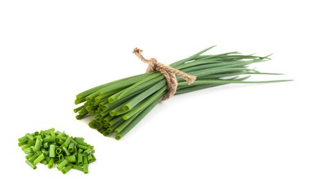 Chives bunch and chopped chives  isolated on white background