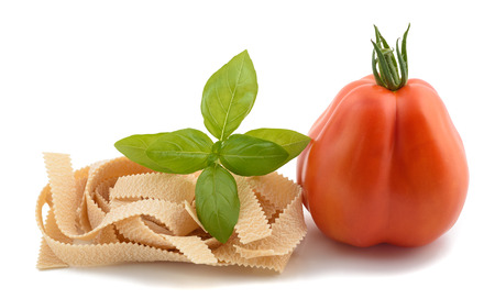pizzoccheri: tomato pappardelle and basil isolated on white Stock Photo