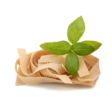 pizzoccheri: pappardelle noodles and basil isolated on white