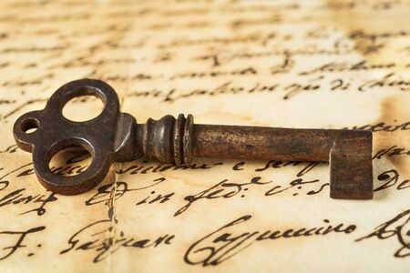 manuscript: Old key on letter background Stock Photo