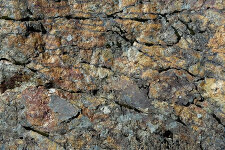 Colorful background  textured stone with iron oxide