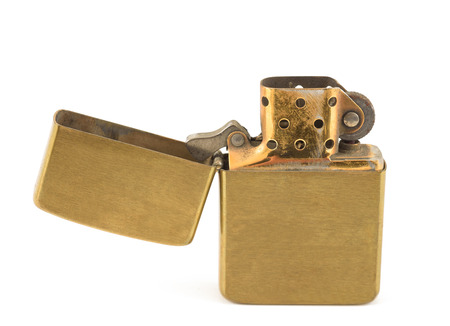gas lighter: A vintage zippo lighter opened isolated on white. Stock Photo