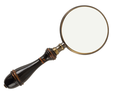 Vintage magnifying glass isolated on white background