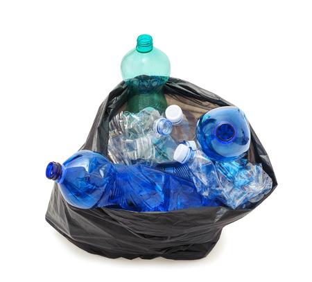 black plastic garbage bag: Black garbage bag with plastic bottles isolated on white