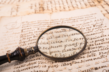 Old magnifying glass on old handwriting Stok Fotoğraf - 62317065