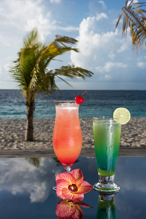Two cocktails in a beach whit flower