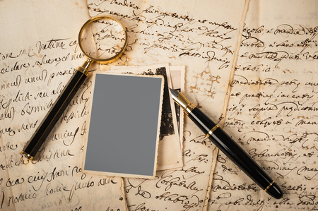 Images and letters with fountain pen and magnifying glass